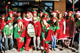 Christine, standing second from left, during Wonder Works' annual kickoff to the holidays